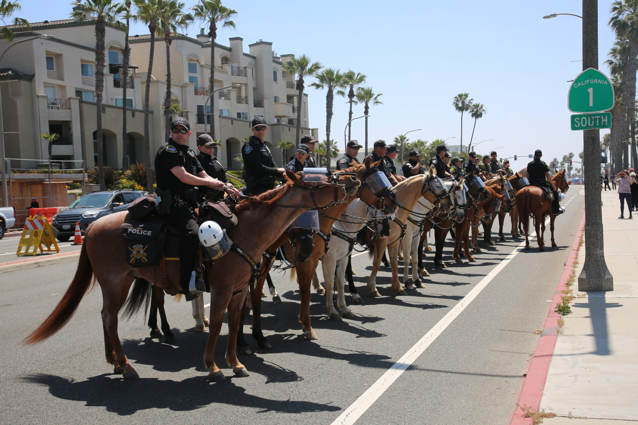 Police at shutdown protest in Huntington Beach, California, May 1, 2020 (mikeledray/Shutterstock.com)