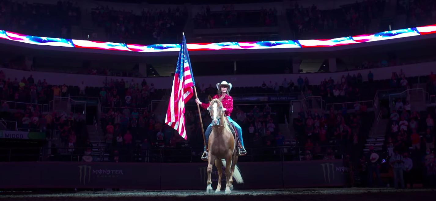 South Dakota Governor Kristi Noem rides a horse at the Monster Energy Team Challenge. (PBR/Youtube screenshot) spectator.org