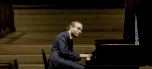 Adam Golka in 32@32 concert at Saint Thomas Church in New York City, Oct. 24, 2020 (YouTube screenshot) spectator.org