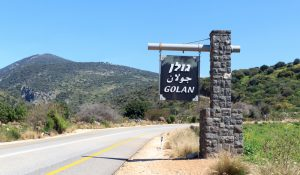 A sign in Israel showing Arabic, English, and Hebrew spellings of Golan - JohannesS - Shutterstock - spectator.org