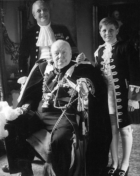 "Three generations, now sadly all gone, in court dress for the Coronation of Queen Elizabeth II: Randolph, Sir Winston, and ""young Winston,"" 1953 (Toni Frissell/Wikimedia Commons)"