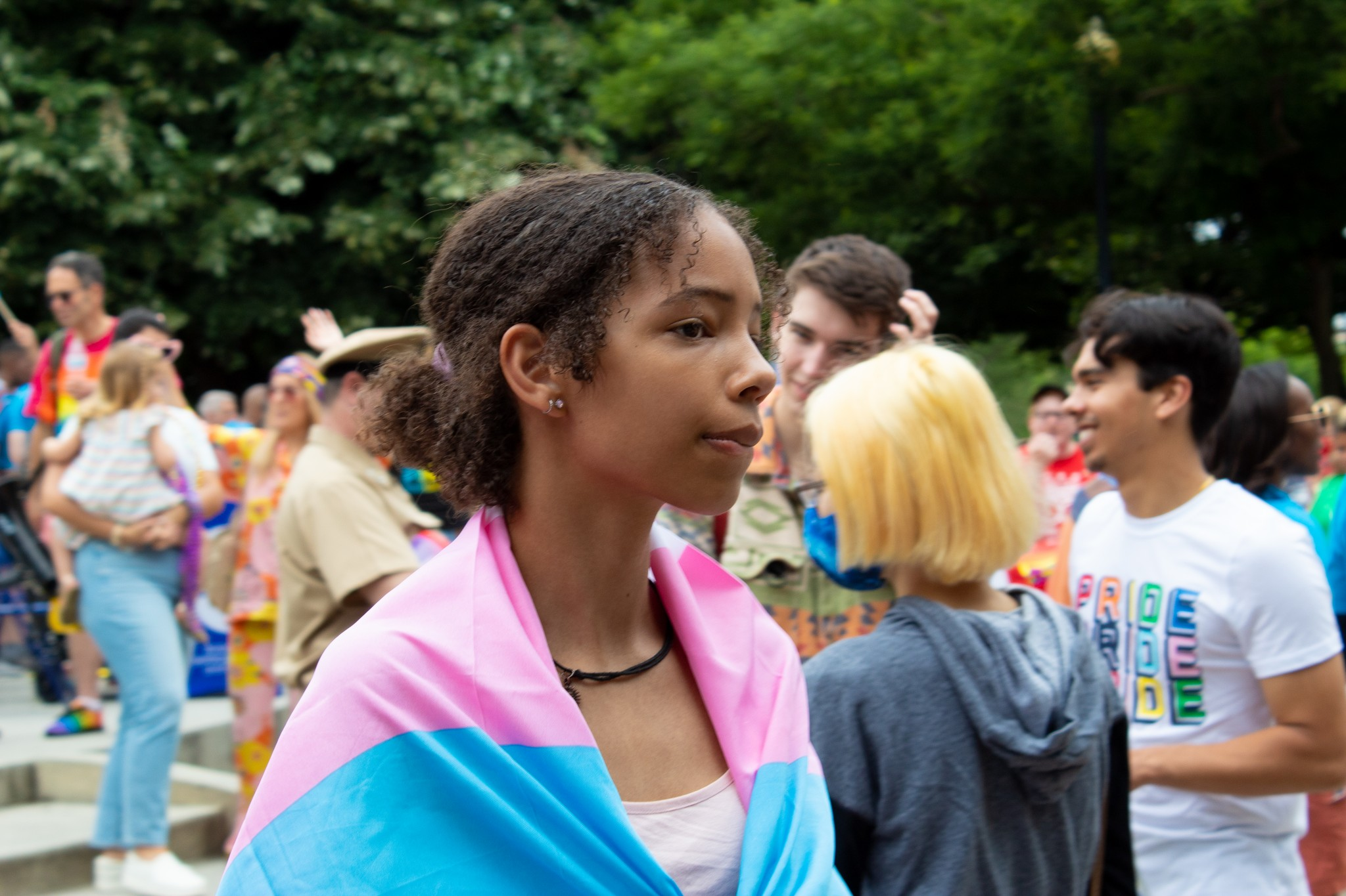 A child listens to speakers at Capital Pride on June 12, 2021 (The American Spectator)