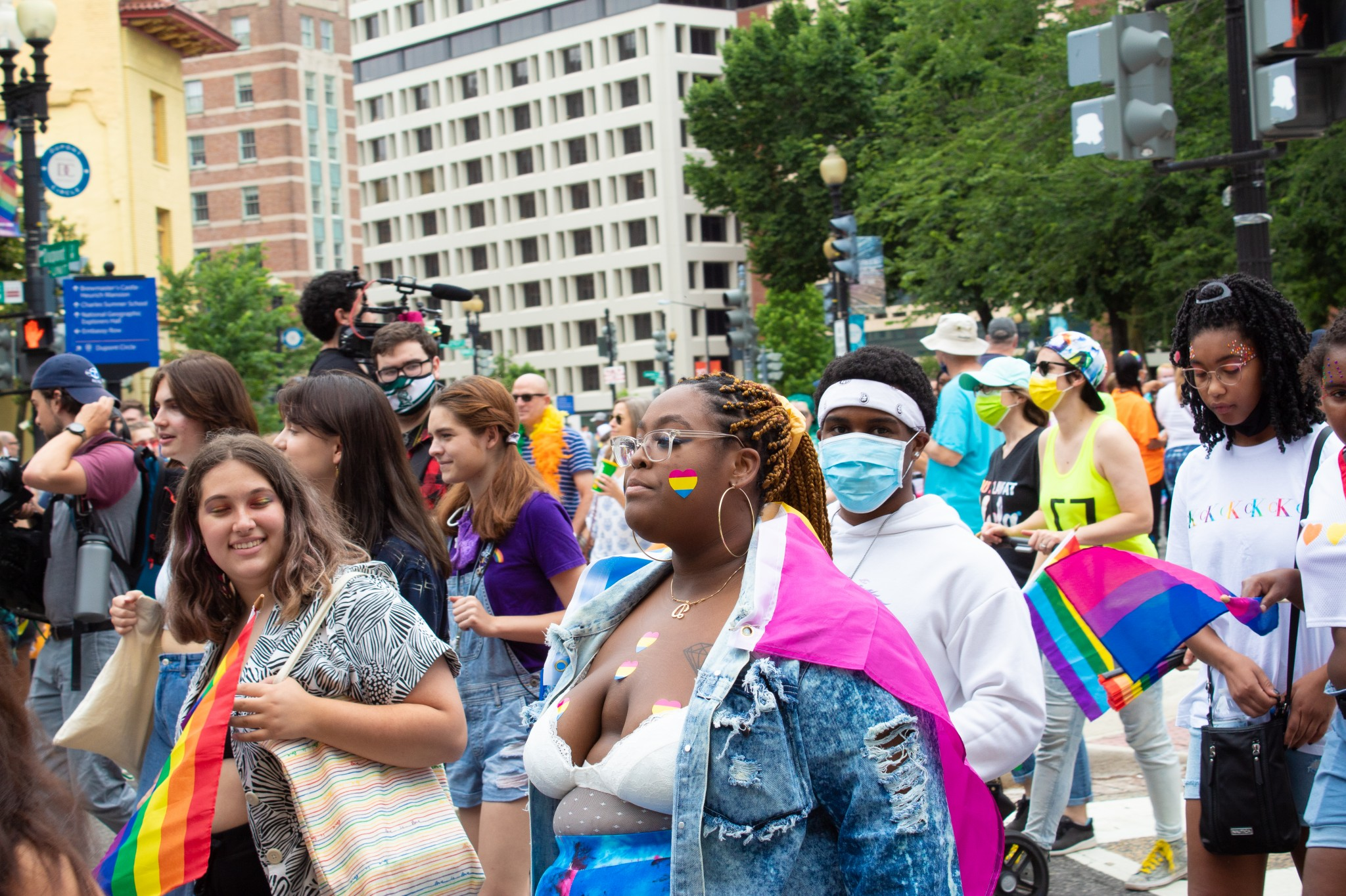 A woman is decked out in stickers with pansexual pride colors at Capital Pride on June 12, 2021 (The American Spectator)