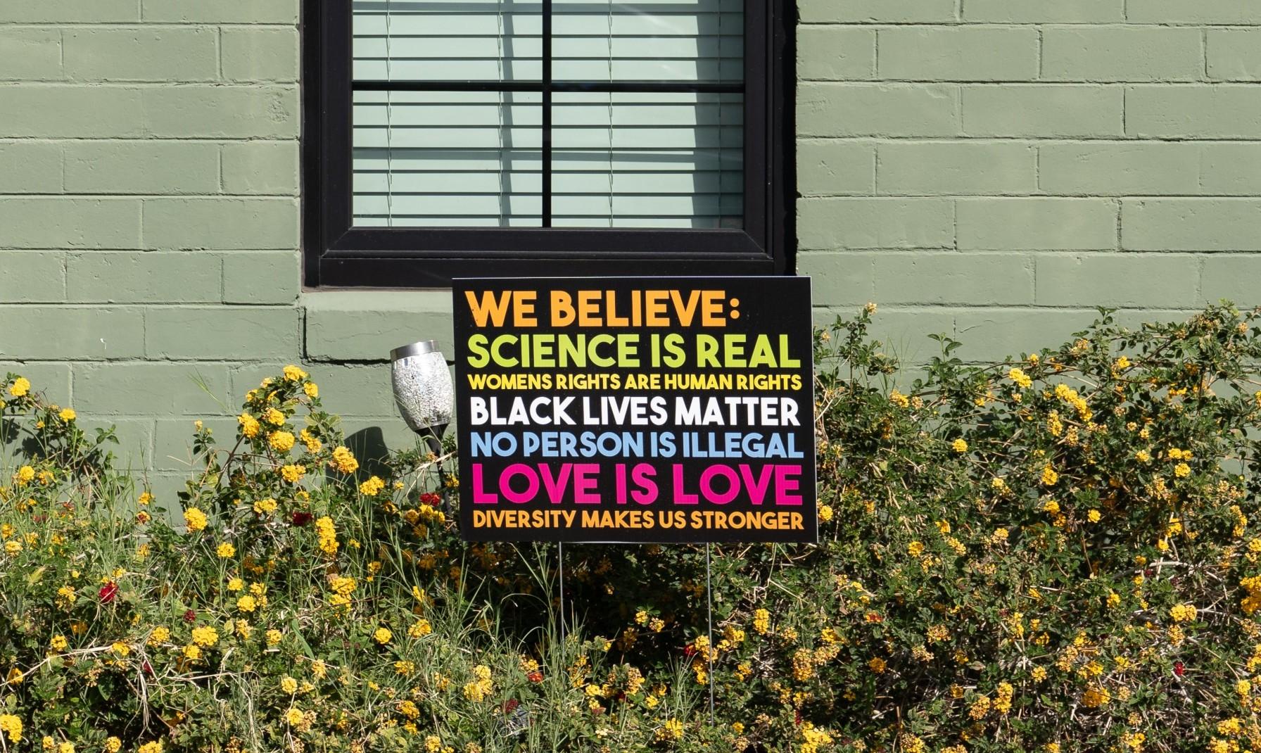 """We Believe science"" sign, Phoenix, Arizona, March 20, 2021 (Rosemarie Mosteller/Shutterstock.com) spectator.org"