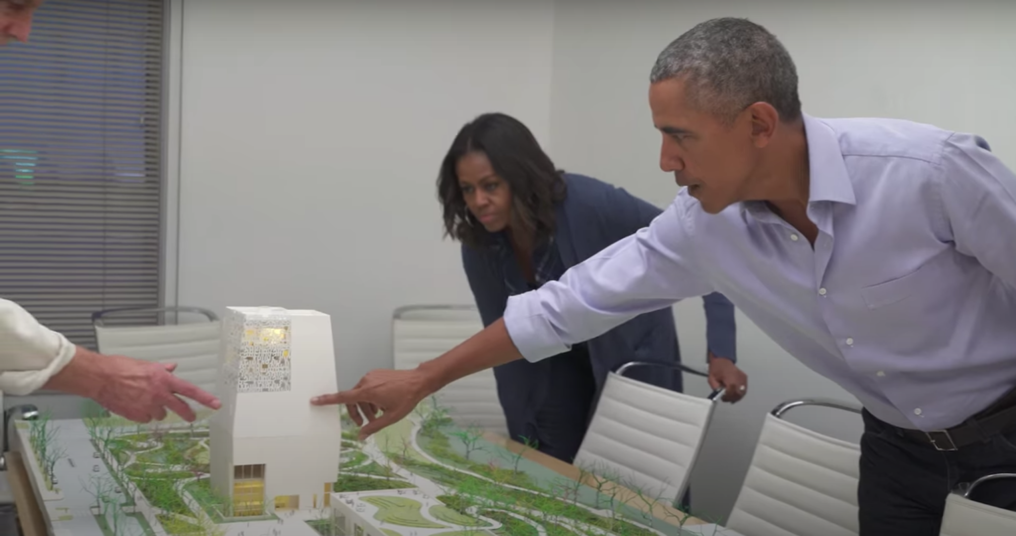 Obama examines the model of the campus of the Obama Presidential Library. (Obama Foundation/Youtube)